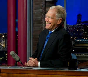 110613-N-TT977-230 Navy Adm. Mike Mullen, chairman of the Joint Chiefs of Staff shares a laugh with David Letterman during an interview on the Late Show in New York City on June 13, 2011. DoD photo by Mass Communication Specialist 1st Class Chad J. McNeeley/Released)